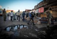 UNLOOTING: SANDF, SAPS and CPF retrieve looted goods in Alexandra, Gauteng
