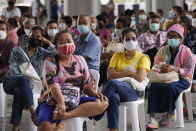 Thailand tightens measures as daily cases cross 10,000