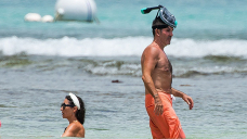 Simon Cowell, 60, Appears to be like to be like Buff As He Goes Shirtless On The Seaside With Son Eric, 7, & Lauren Silverman
