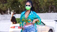 Rihanna Wears Denim Mini Skirt As She Flirts For The Camera Whereas Selling Fenty Gloss Bomb Warmth – Photo