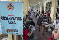 Thousands jam Philippine vaccination sites over false news