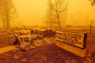 Charred buildings, burned cars and an abandoned metropolis: Haunting photos of California wildfire aftermath