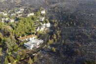Greek firefighters battle huge wildfires with reinforcements