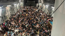 Photo: Broad US military cargo plane transports fleeing Afghans
