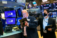 Dow falls more than 200 points as July retail sales decline