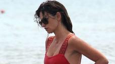 Penelope Cruz Stuns In White Bandeau Top & Cramped Dark Bikini Bottoms While Swimming In Italy