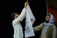 Defiant Afghans wave flags as Taliban foe's son vows resistance