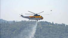 California crews battle 12 big wildfires