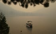 Lake Tahoe shrouded in smoke from surging Caldor fire – in pictures