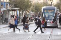 Teen girl falls down manhole on main street in Jerusalem