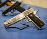 Suspect in custody shoots himself with police firearm