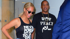 Beyoncé Rocks Flared Denims In Candy Current PDA Photos With Husband Jay-Z