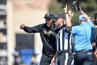 Colorado football coach Karl Dorrell smacks camera after Buffaloes' blowout loss to USC