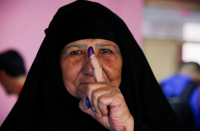 Iraqis vote in general election with a low turnout reflecting the nation's apathy