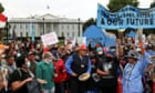 Indigenous activists march in Washington to demand action on climate crisis – live