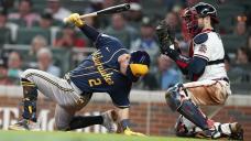 Bats finally wake up but Hader falters, Brewers eliminated
