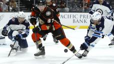 McTavish, 18, scores in NHL debut as Ducks beat Jets 4-1